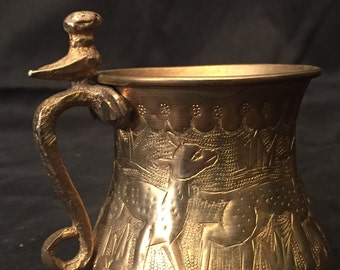 Hand engraved brass cup