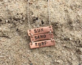 Sun Sand Surf copper ladder necklace