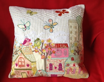 Appliqué cushion houses , trees and recycled fabric