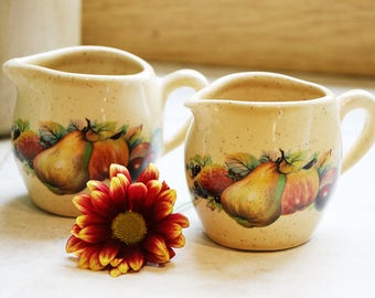 Pair of small ceramic jugs by Fontmell Potteries, Dorset; c.1980; apples and pear decoration; pottery jugs; decorative pottery;