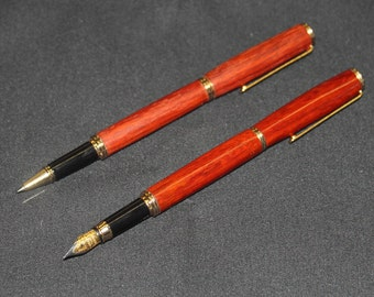 Paired roller ball and fountain pen set