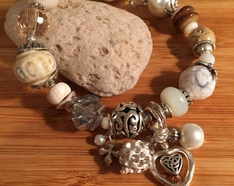 Cream Crush - chunky, eclectic, neutral-colored boho bracelet with bling and a tassle charm; crystals, gemstones, glass, and silver metal