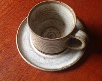 Vintage pottery teacup and saucer