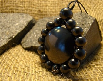 "Shungite pendant ""Flower"" from Karelia beads mascot."