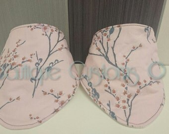 pair of pink dribble / bandana bibs