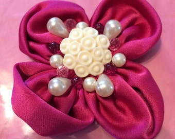 Magenta fabric flower brooch and multicolored beads