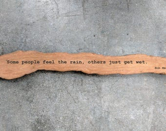 "Bob Marley Quote - Engraved Driftwood - ""Some people feel the rain, others just get wet."""