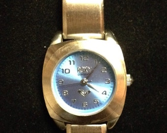 Vintage ladies Roxy watch by QuikSilver. RX211 blue on silver bangle bracelet style