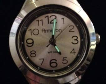 Armitron Sport ladies analog easy read watch. 25/6418. Silver w black resin band. Luminescent hour & min hands