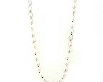 Long, hand knotted freshwater pearls, with suede cord.