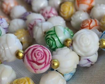 Celluloid? Lucite? Long White/MulticOlor Carved Flowers w/ Goldtone Spacers