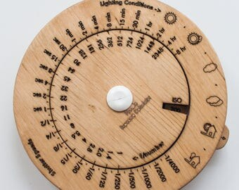 Wooden pinhole exposure meter.