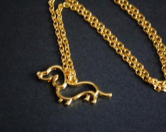 gold tone sausage dog necklace