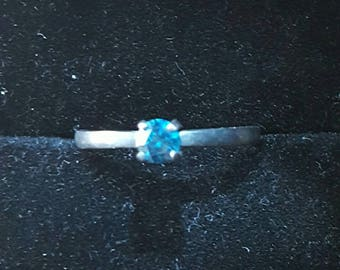 4mm blue diamond and oxidized silver ring. Size 8.