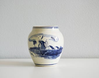 Small vase. Small white blue vase. Small white vase. Small blue vase.