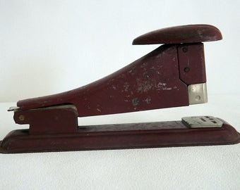 Vintage red metal stapler