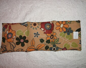 Heat Pack, rice filled. Microwaveable, can be used for warm or cool therapy, for relaxation or pain relief. Autumn Floral/Olive fabric.