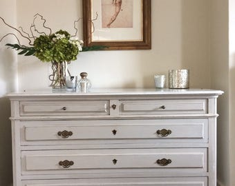 Continental painted marble top chest of drawers