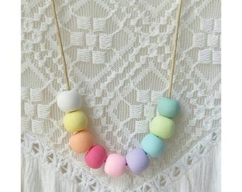 Kids Polymer Fimo Clay Rainbow Bead Necklace on tan cord