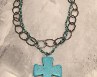 "Turquoise Magnesite 2""cross with gun metal chain & turquoise rosary chain."