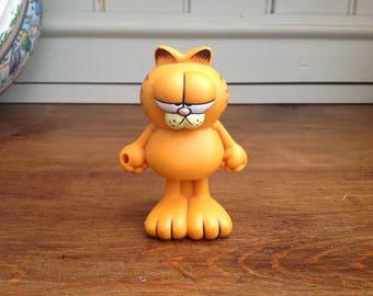 Vintage plastic Garfield figure with detachable face 1980s