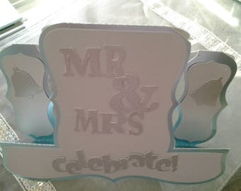 a silver and blue wedding card