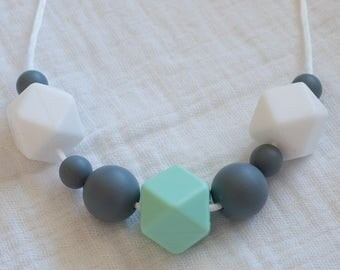 Spring showers silicone teething necklace, in mint
