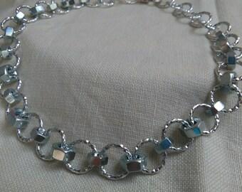 Necklace-Bracelet with bolts