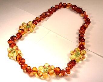 Natural Baltic Amber Children Necklace with a Lemon Flower and Cognac Beads