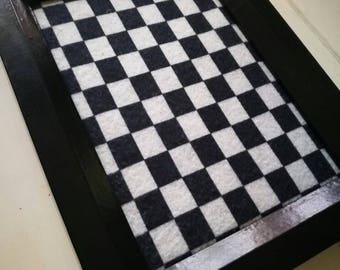 Checkered dice tray.