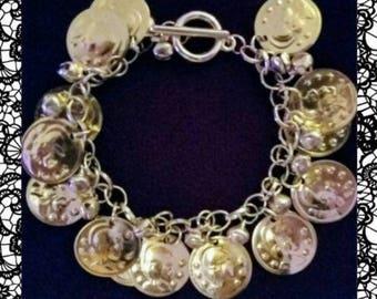 Gold coloured coins and bells bracelet