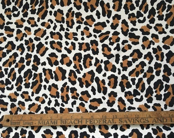 Black Brown Leopard Print Stretch Swimsuit Fabric on White background nylon lycra blend athletic fabric