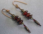 Copper and Red glass beads come together in these handmade Earrings.
