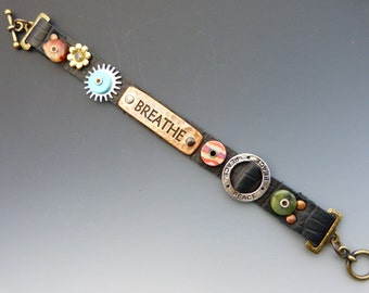 Black Leather and Copper Breathe Bracelet with a Toggle Clasp