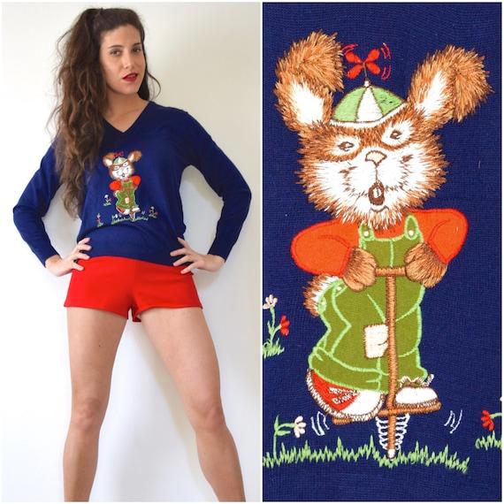 SUMMER SALE/ 30% off Vintage 70s Bunny on a Pogo Stick Navy Blue Knit V-Neck Sweater (size small, medium)