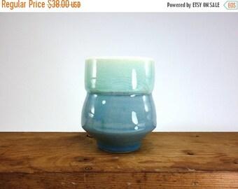 ON SALE Celadon glazed porcelain tea bowl with dark blue brushed slipped and carved wave pattern