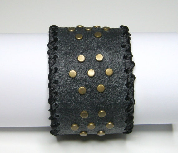 FABRIC CUFF BRACELET: Art piece.  With antique finish brass studs. Medium to large. Handmade by Procione.