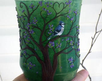Blue jay in a Blossom Tree with a Heart in the Branches Sculpted with Polymer Clay onto a Recycled Glass Candle Holder in Green
