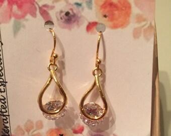 Beautiful Clear CZ set loosely in a Teardrop Casings, Gold Earrings