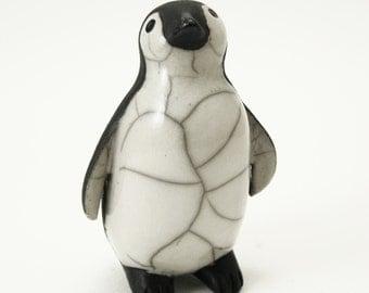 Penguin chick looking up - ceramic raku fired sculpture