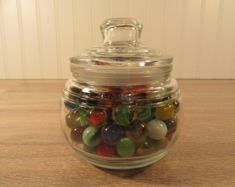 170 vintage glass marbles in  round glass jar with lid