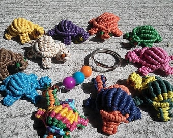 Custom Mini macrame turtles in various colors can be keyrings, magnets or charms for purses, zippers or bracelets.