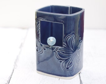 Blue window vase with little bird