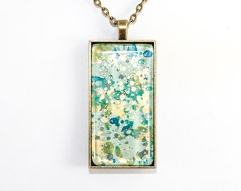 Splatter Painting Pendant - Abstract Art - Glass & Brass Rectangle Necklace - Caribbean Waters Colorway: Aqua, Green, Blue, Gold, Teal