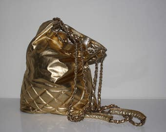 Gold quilted bucket bag