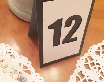 Understated elegance in black and white.  Table tent numbers 1-12.  Perfect for weddings, rehearsal dinners, baby showers.