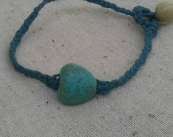 Turquoises heart bracelet on blue hemp