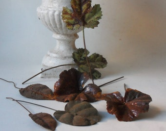 seven vintage rusty tin leaves