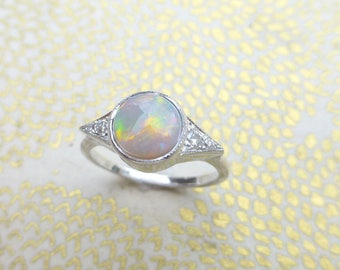 Opal engagement ring.  Round opal ring with diamonds.