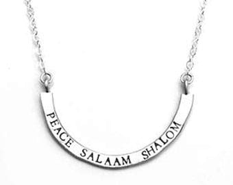peace salaam shalom — stamped silver arc necklace